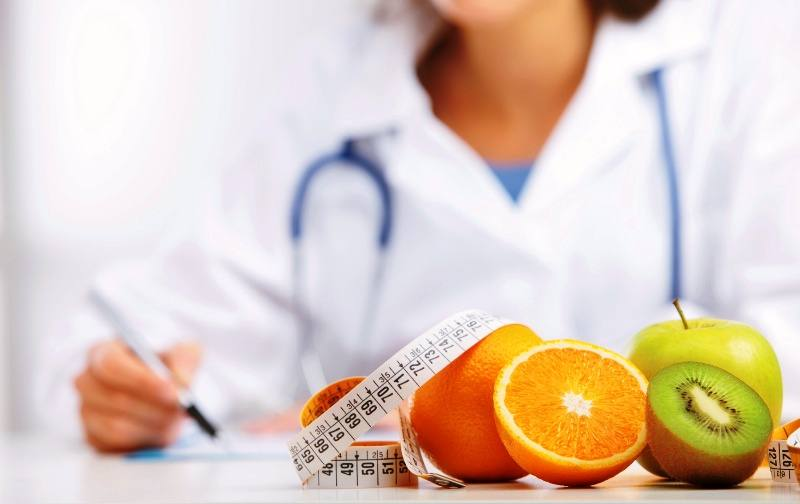 Nutritionist Doctor is writing a prescription. Focus on fruit